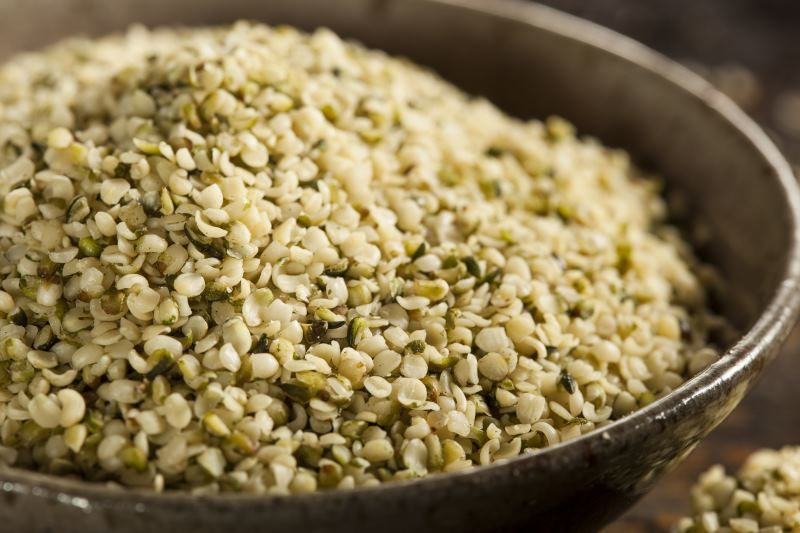 A close-up of hulled hemp seeds in a bowl.